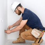 professional-overalls-with-electrician-s-tool-white-wall-background-home-repair-electrical-installation-concept