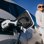woman-charging-electro-car-by-her-house